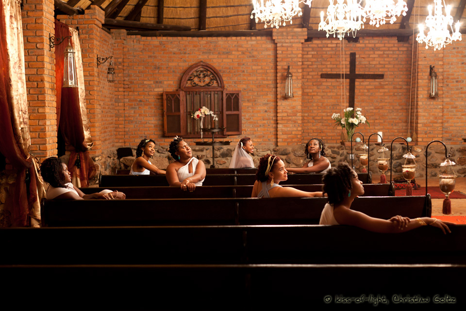 Bridesmaids relax in a chapel after the wedding